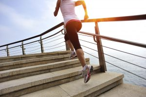 healthy lifestyle asian woman running at stone stairs seaside